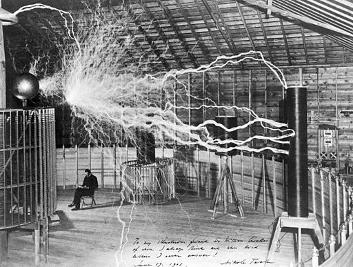 Nikola Tesla with his equipment